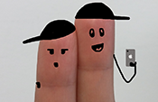 two fingers decorated as people taking selfie